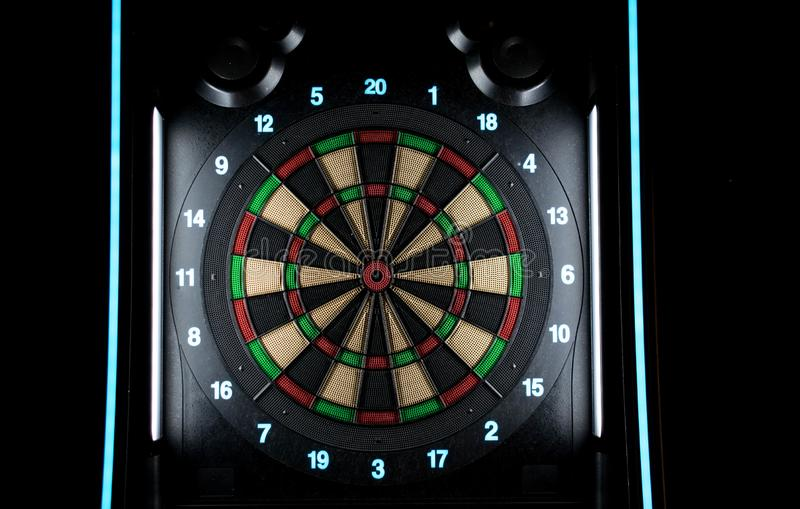 Take your darts and hit the target. A colorful and modern dartboard filled with lights of different colors royalty free stock images