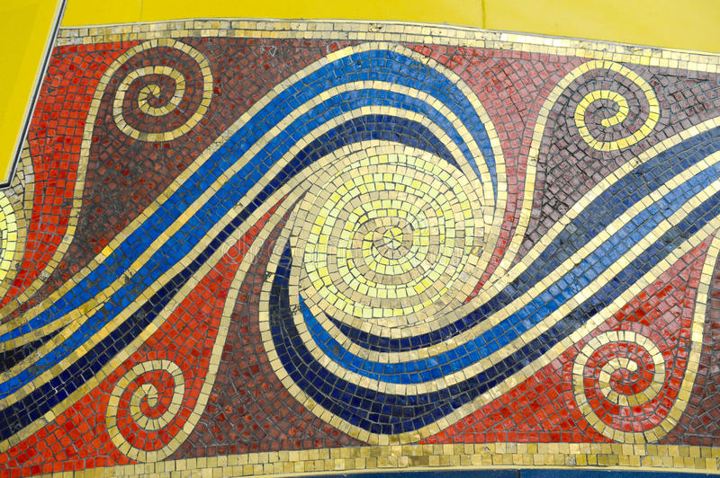 Colorful Mosaic. On a slightly curved wall in a bathroom stock photos