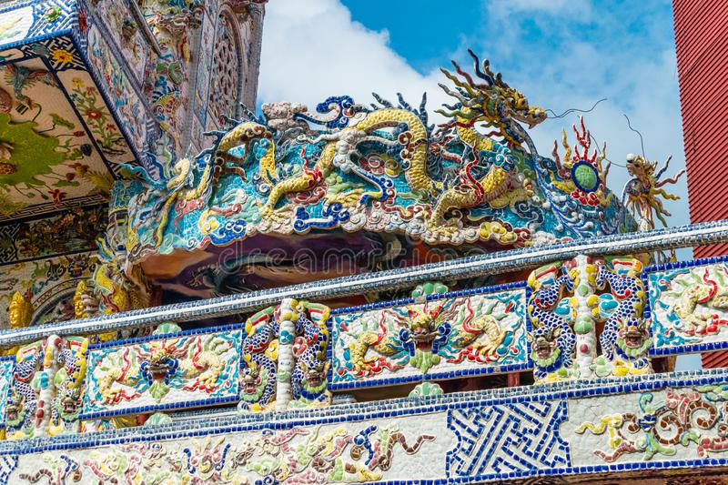 Colorful mosaic of porcelain in shape of dragon in ancient temple in Dalat Vietnam. Colorful mosaic of porcelain in shape of dragon in an ancient temple in Dalat royalty free stock image