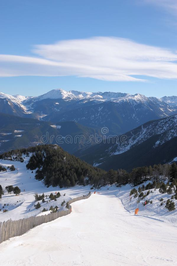 Colorful mountain landscape - mountains covered with snow and overgrown with fir trees, Vallnord, Principality of Andorra, Europe. royalty free stock images