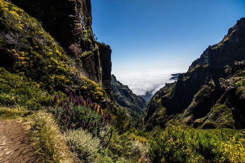 Colorful mountain ridge path with volcanic formations beside, Pico do Arieiro, Madeira, Portugal stock photography