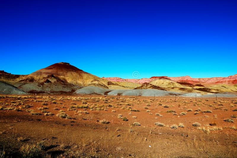 Colorful mountain side under bright blue sky royalty free stock photo