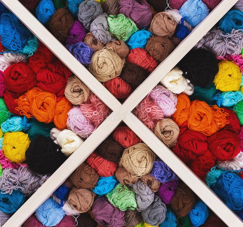 Colorful multicolored skeins. Crocheting and knitting. Colorful multicolored skeins of yarn in the box on white background. Women`s hobby. Banner stock photos