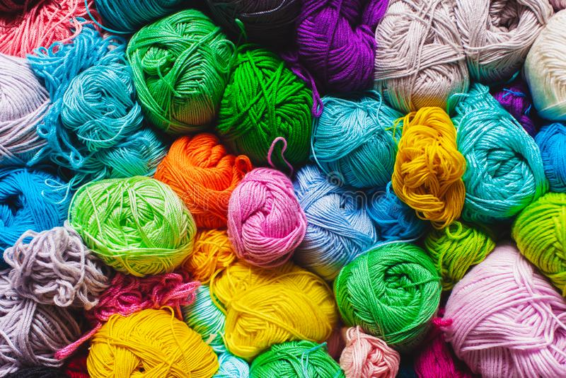 Colorful multicolored skeins. Crocheting and knitting. Colorful multicolored skeins of yarn in the box on white background. Women`s hobby. Banner royalty free stock image