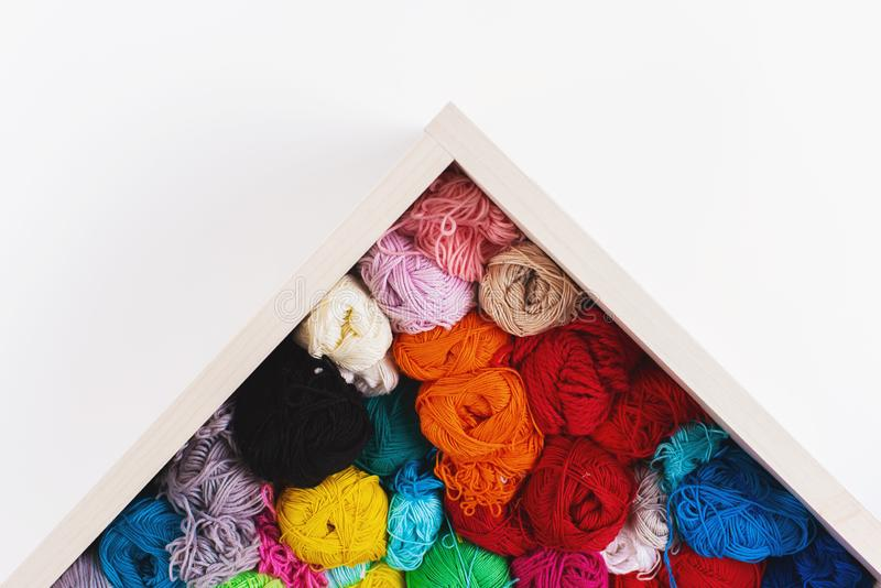 Colorful multicolored skeins. Crocheting and knitting. Colorful multicolored skeins of yarn in the box on white background. Women`s hobby. Banner royalty free stock photo
