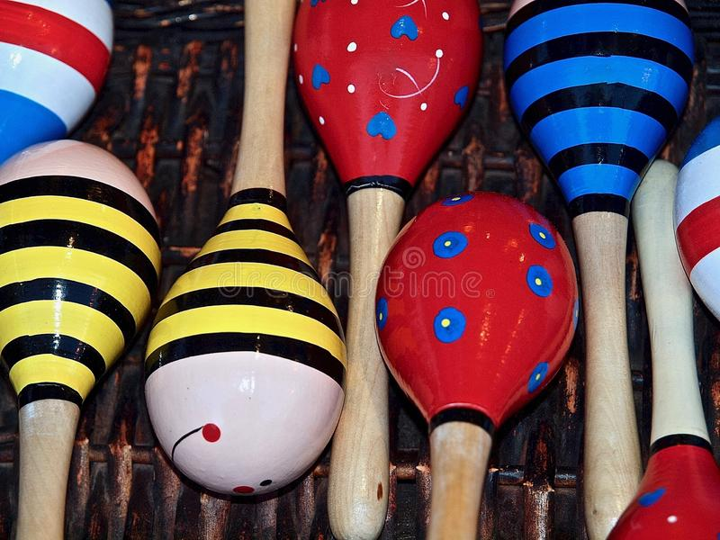 Colorful music instruments out of wood in Portugal. Colorful wooden music instruments for children at a market royalty free stock photos