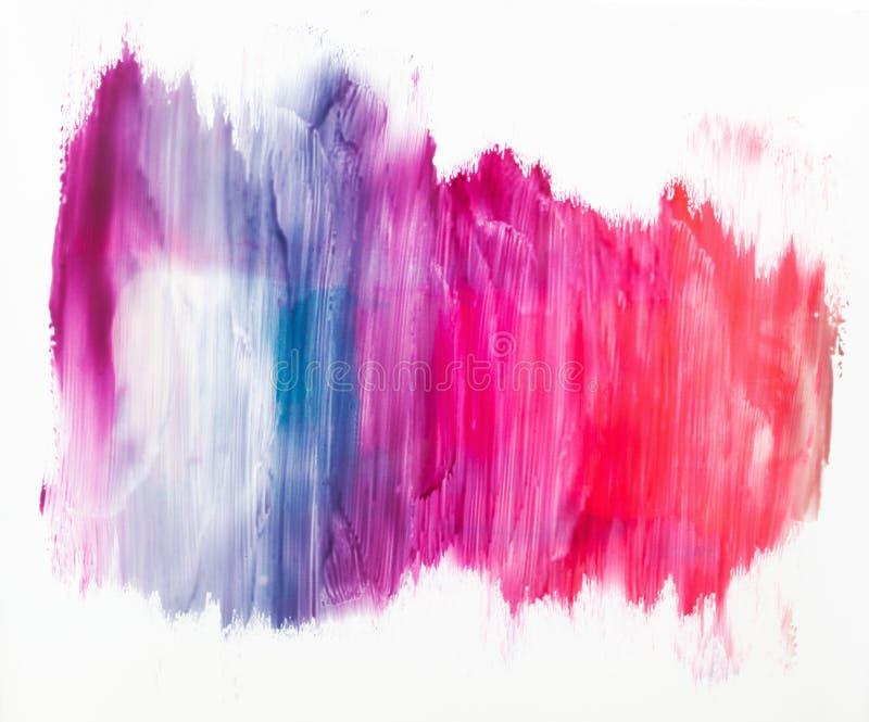 Colorful nail polish smashes on white background stock photos