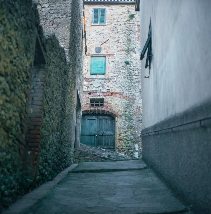 Colorful narrow streets in the medieval town of Campiglia Marittima in Tuscany with slide film photography - 1. Colorful narrow streets in the medieval town of stock photo