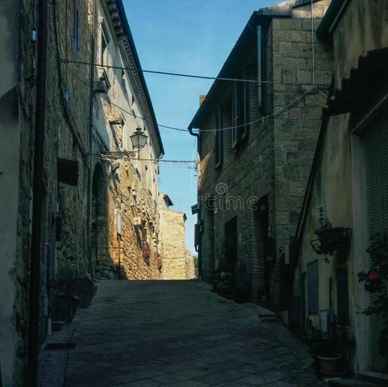 Colorful narrow streets in the medieval town of Campiglia Marittima in Tuscany with slide film photography - 2. Colorful narrow streets in the medieval town of stock image