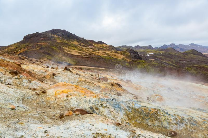 Colorful landscape in Krysuvik geothermal area iceland, cloudy sky. Colorful natural landscape in Krysuvik geothermal area iceland, cloudy sky royalty free stock images