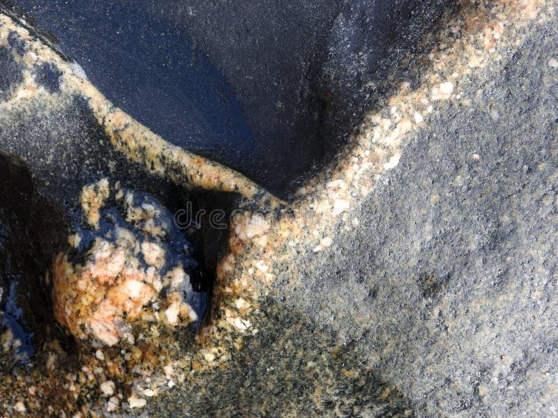 Colorful natural stone surface near sea, Lithuania stock photo