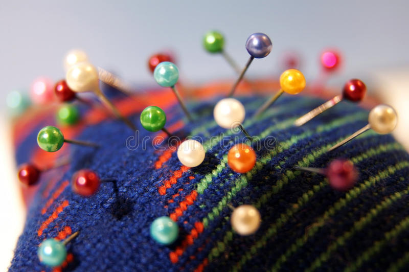 Colorful needle bed with pins royalty free stock photo