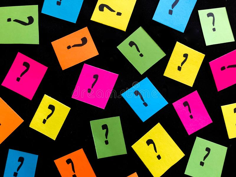Colorful Neon Question Marks on Black Background stock photography