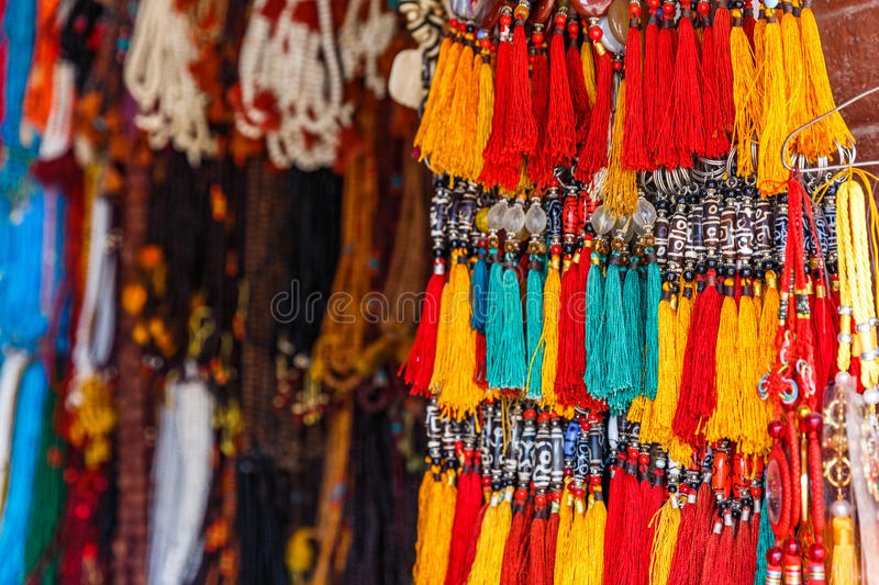 Colorful nepalese keyrings. Close up photo of colorful nepalese keyrings royalty free stock image