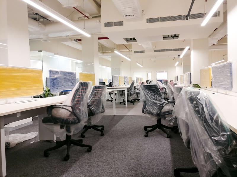 Colorful new office with the plastic covers still on the furnitu. Colorful new office with cubicles, chairs, tables and carpets. The plastic polythene covers are royalty free stock photo