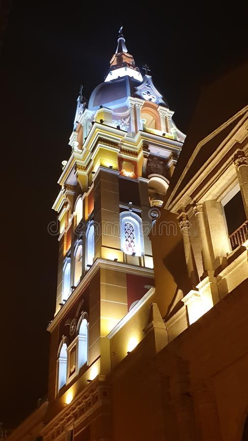 Colorful night illumination of the cathedral tower, Cartagena, Colombia stock photos