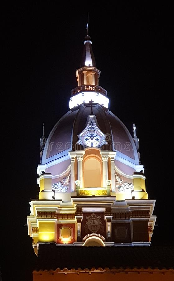 Colorful tower of the cathedral at night, Cartagena, Colombia royalty free stock photos