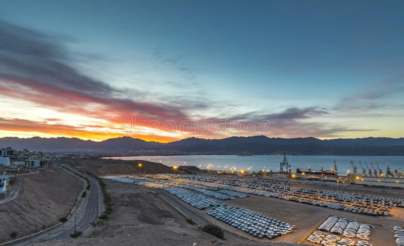 Colorful night and sunrise near marine port of Eilat. Photo was taken in stone desert near southernmost marine port of Israel - Eilat marine port royalty free stock images