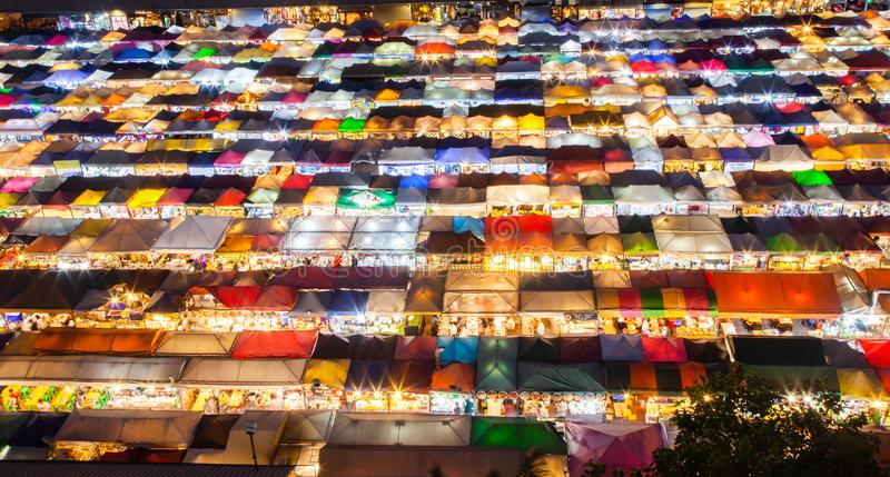 Colorful Night Train Market Ratchada, Bangkok, Thailand. Asia, view, street, city, travel, light, food, building, modern, landmark, cityscape, outdoor stock photo