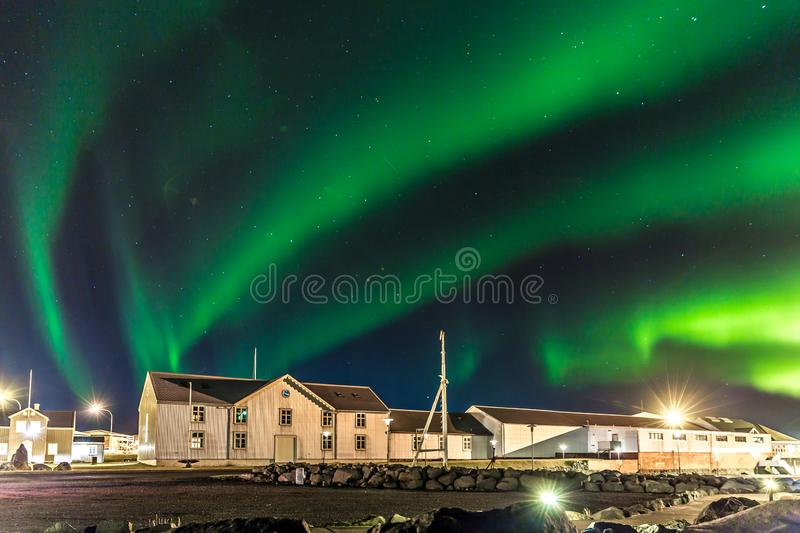Colorful northern lights Aurora borealis with a warehouse in the foreground in Iceland stock photos