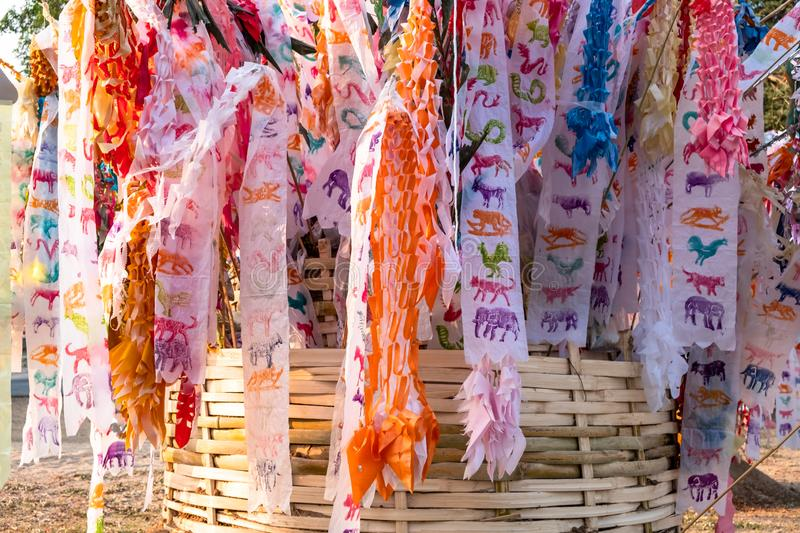 Colorful northern Thai traditional flag or `Tung` hanging on the sand pagoda during Thai New Year a.k.a. Songkran Festival. royalty free stock photography