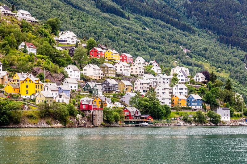 Colorful norwegian residential houses on the hill of Sorfjord, Odda, Hordaland county, Norway stock photos
