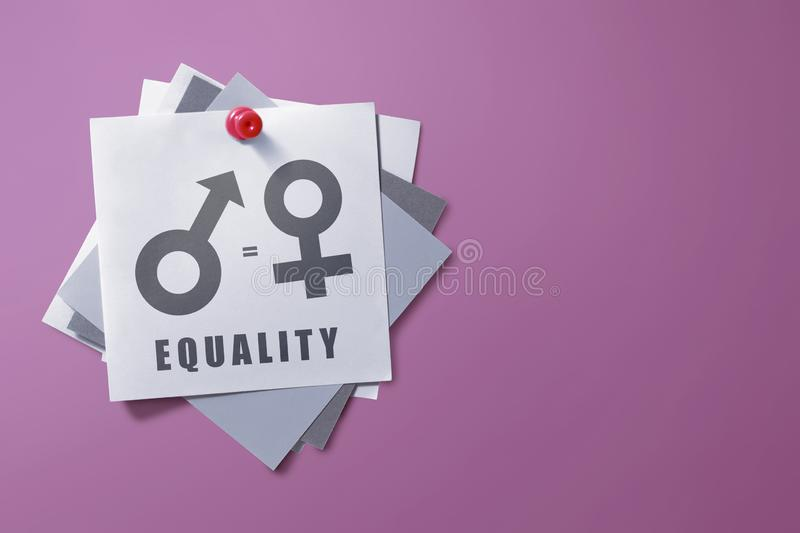 Colorful note paper with symbol of gender equality stock image