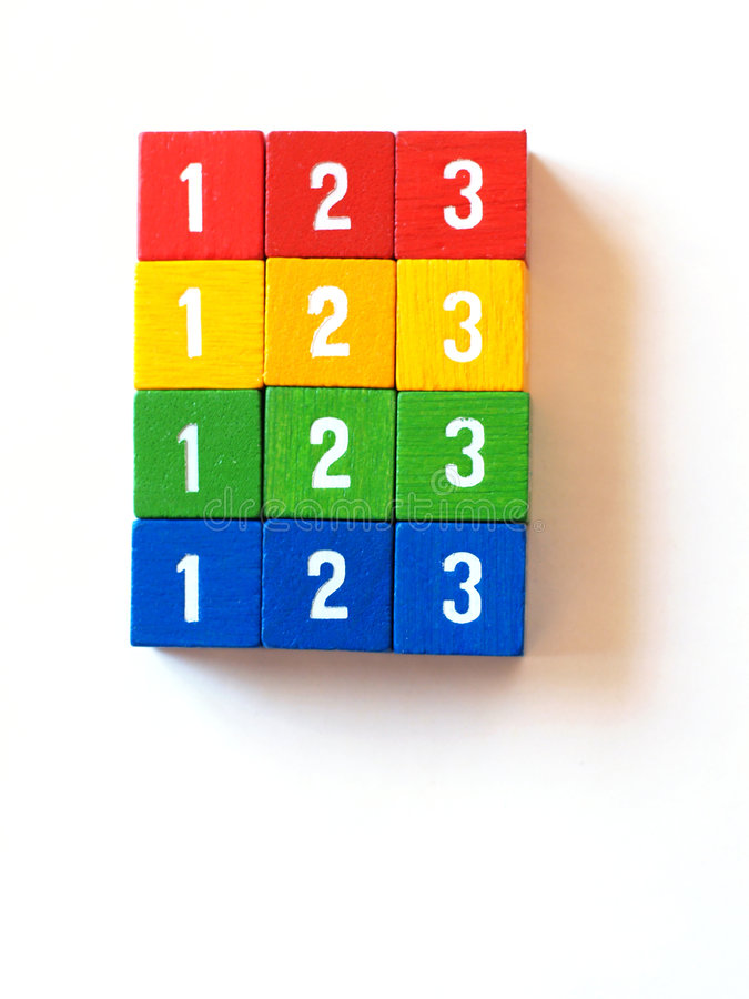 Colorful numbered blocks for learning (III). Rainbow of numbered wooden blocks suitable for use in the classroom or for games stock photography