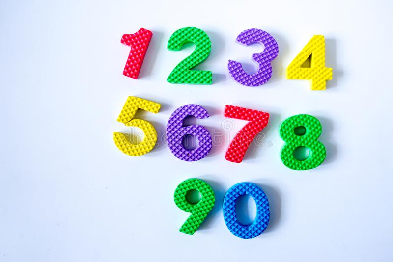 Colorful numbers isolated on white background. Yellow green pink red royalty free stock photos