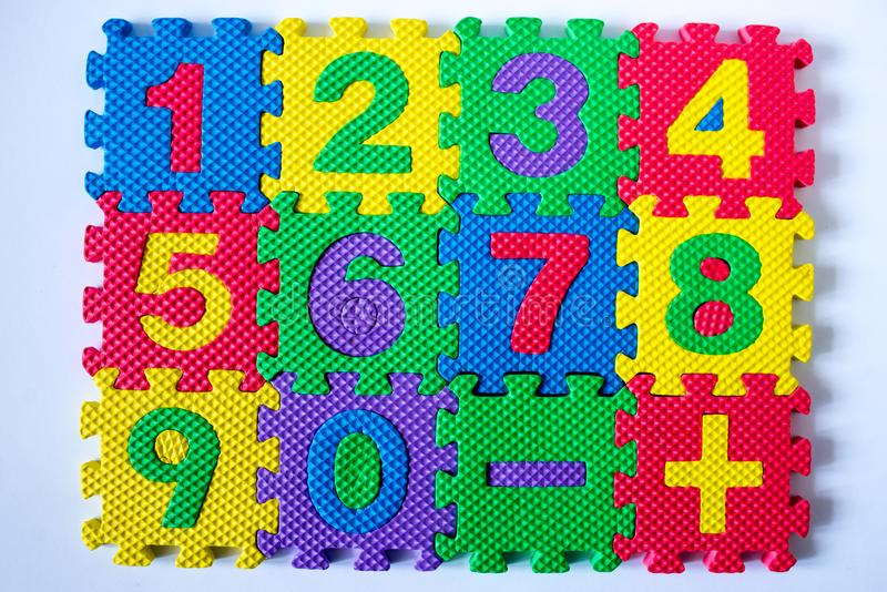 Colorful numbers isolated on white background. Yellow green pink red stock photography