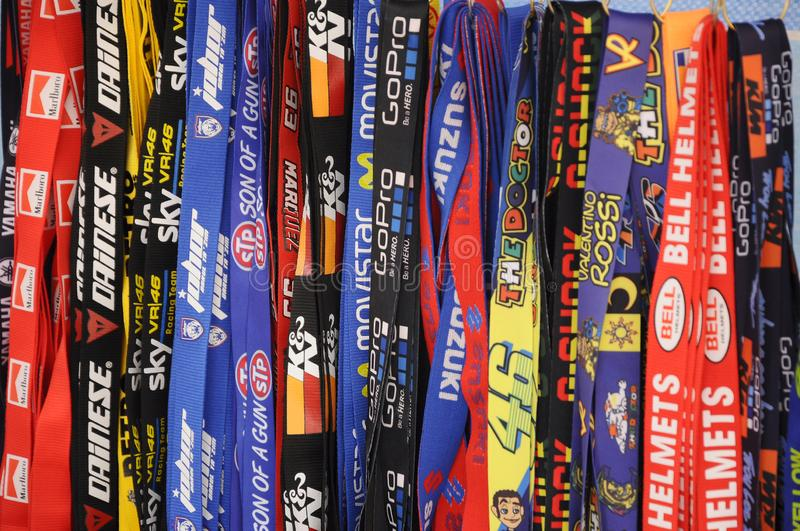 Colorful nylon neck strap with a famous motorcycle brand and other famous product brand printed on it. stock photos