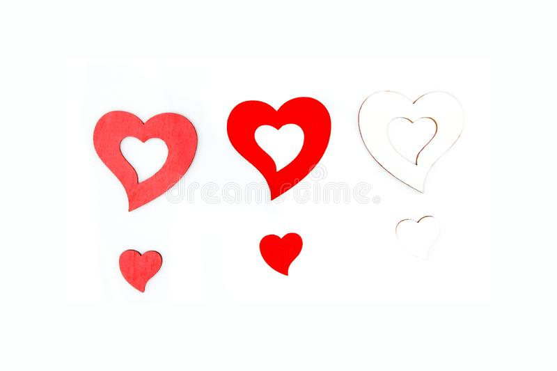 Colorful object and valentine day concept. Three big hearts and small isolated on white background. stock photo