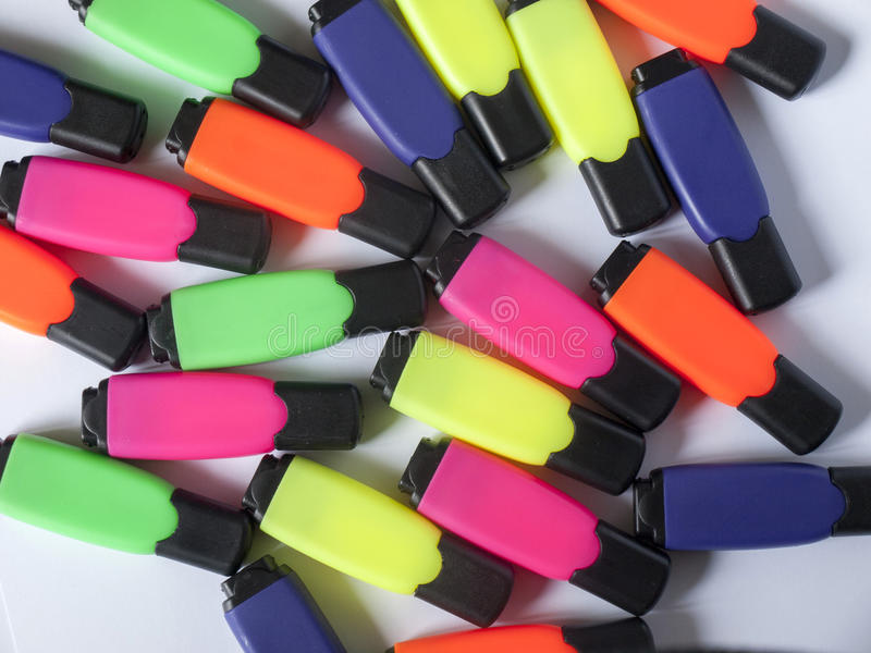 Colorful office markers on white royalty free stock photography