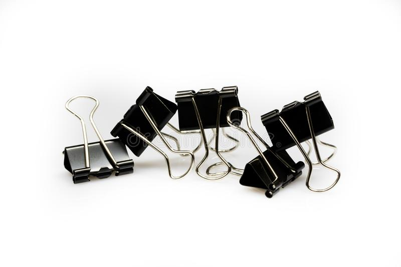 Colorful office paper clips on white ground. Office acc. Essories on a white table. White background stock image