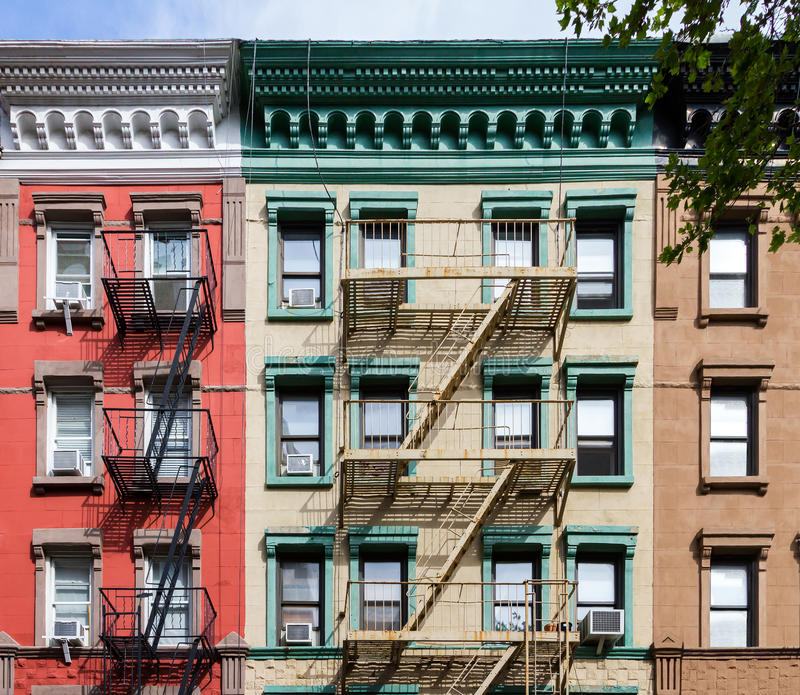 New York City Flats: Colorful Old Apartment Buildings In New York City Stock