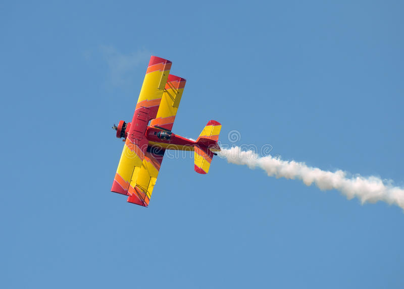 Colorful old biplane. Old biplane in bright colors performing stunts stock image