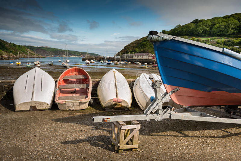 Colorful old boats at low tide. Fishguard, Wales stock images