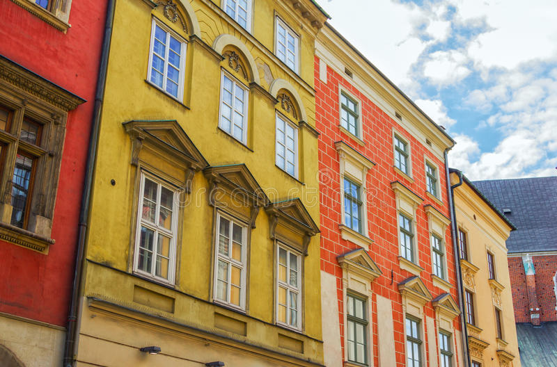 Colorful old buildings in Krakow city center. Houses with red, orange and yellow walls royalty free stock photos