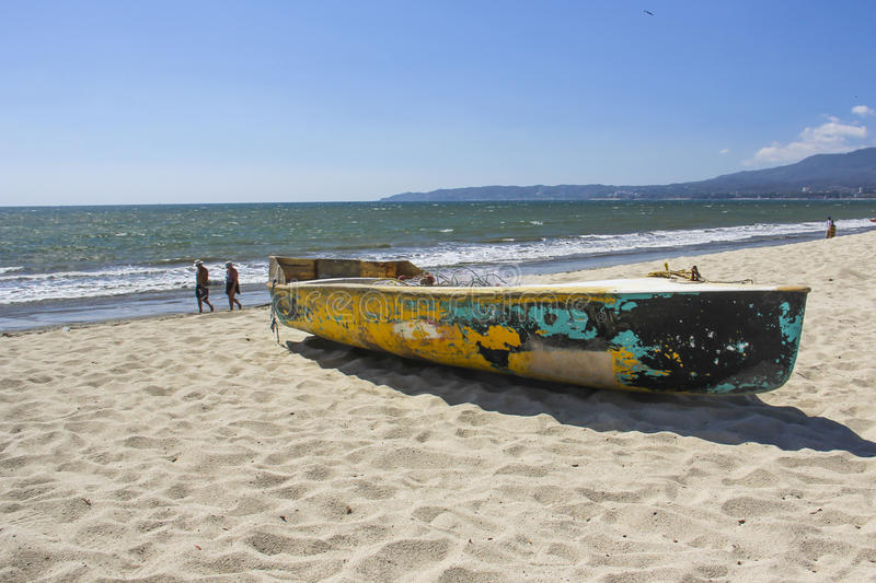 Colorful old fishing boat on the beach. stock photo