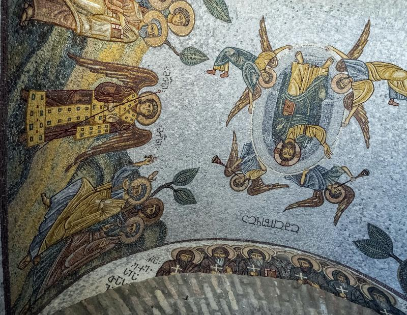 Mosaic on the ceiling of the Church of the Iberian icon of the mother of god on the Holy mountain in Tbilisi. Colorful old mosaic on the ceiling of the Church of stock photography