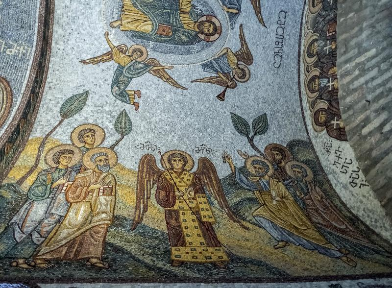 Mosaic on the ceiling of the Church of the Iberian icon of the mother of god on the Holy mountain in Tbilisi. Colorful old mosaic on the ceiling of the Church of stock images