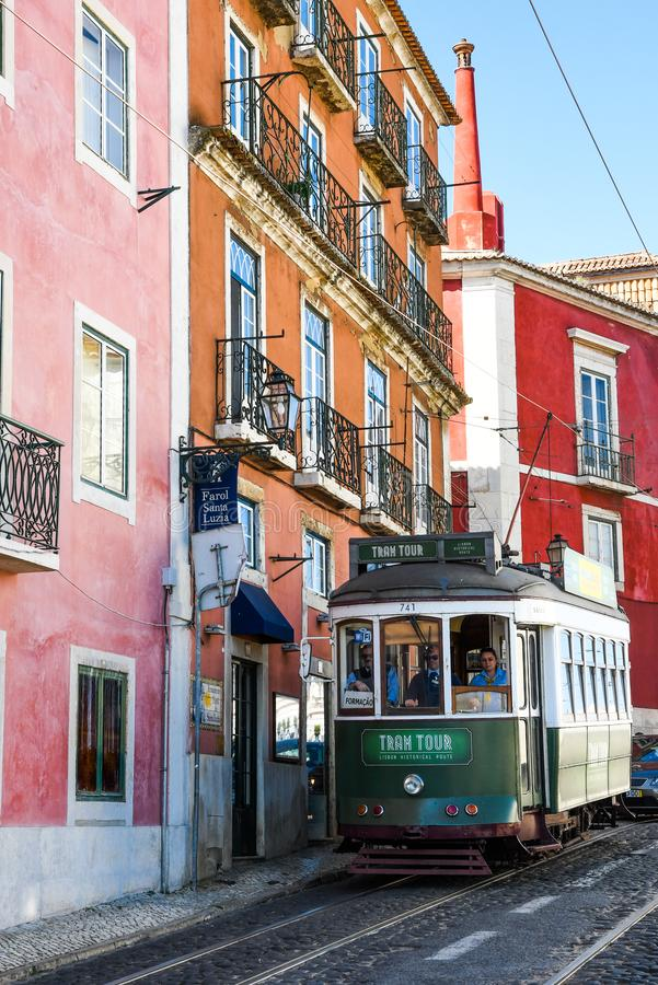 Colorful old tram acrossing colors building royalty free stock photography