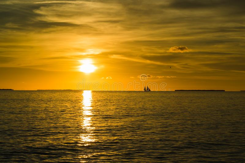 Colorful orange beautiful sunset on sea summer background. Hot and romantic sunset over the ocean. Calm landscape stock photo