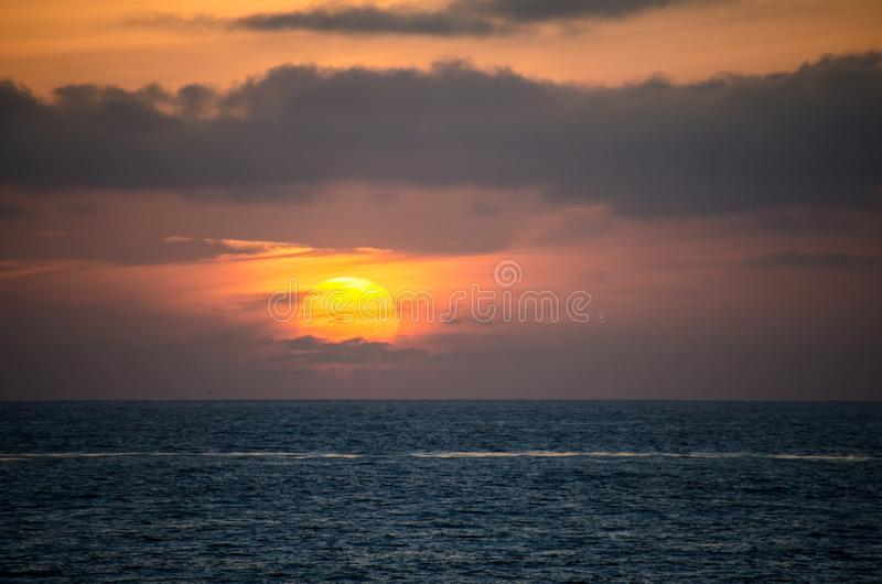 Colorful orange and purple sunset on the Pacific Ocean in La Jolla, San Diego California stock image