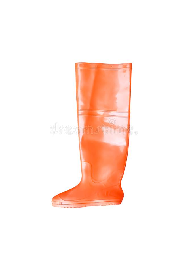 Colorful orange rubber boots isolated on white background with clipping path stock photography