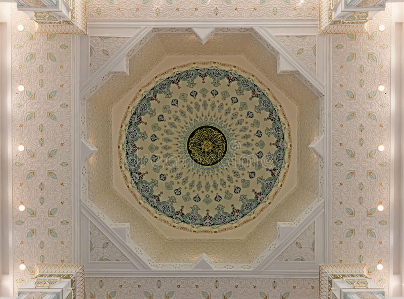 Colorful ornament of the inside of the dome of a Muslim mosque stock image