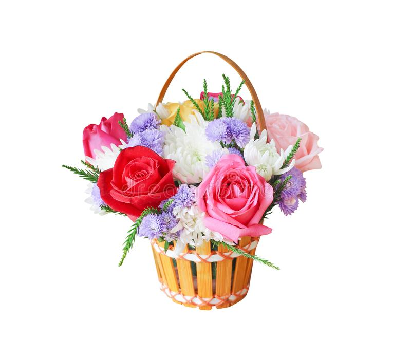Colorful ornamental variety of flowers in the gift wood basket with roses , leaf and chrysanthemum natural patterns isolated on royalty free stock photography
