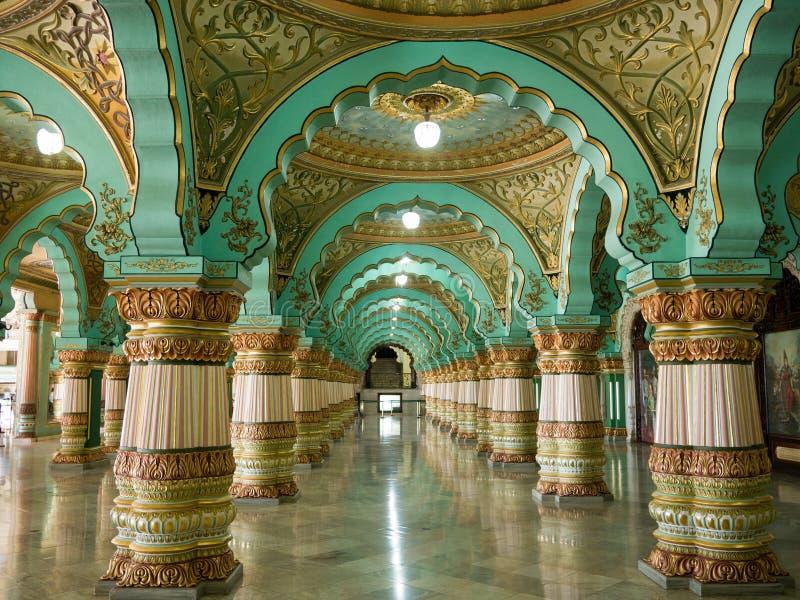 Colorful ornate interior halls of royal Mysore Palace, Karnataka, India. MYSORE, INDIA - January 11 2018: Colorful ornate interior halls of royal Mysore Palace royalty free stock photography