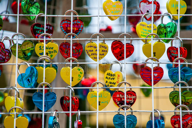 Colorful padlocks heart shaped on blurred background, symbol of love. Sabah, Borneo, Malaysia. Colorful padlocks heart shaped on blurred background, symbol of royalty free stock photo