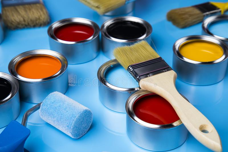 Colorful paint cans with paintbrush stock image